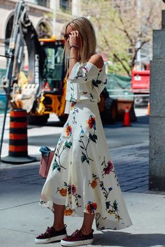 Photos via: The Fashion Guitar Summertime, when the living's easy. We're obsessed with this beautiful floral dress this blogger is sporting. Even better than the print and the shape is the pairings. I