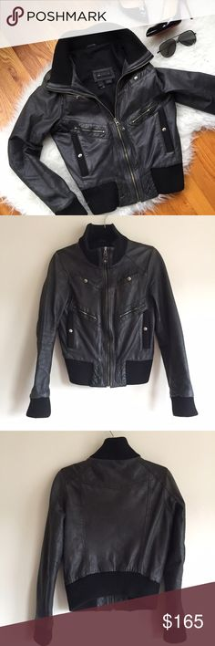 Mango Genuine Leather Bomber Biker Jacket Stay cool and on trend with this amazing genuine leather black bomber jacket by Mango! Love the unique look of this jacket with the elastic ribbing on the waist, cuffs, and collar for a comfortable and warm fit. Has 6 pockets in the front and worn in leather for that unique biker look. Silver hardware. Note that zipper handles on pockets are missing but still functional. Fits the body so well and very flattering! Has some very minor scuffs on the…
