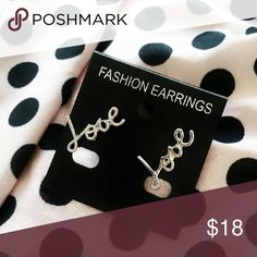 """""""Love"""" Earrings Cute, silver tone earrings that say """"Love"""" in cursive. Additional keywords: word words fancy writting font text english statement reminder kindness kind loving lovable sweet compassion compassionate romance romantic Jewelry Earrings"""