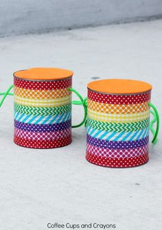 DIY Tin Can Stilts! Such a fun summer craft for kids to make and play with!