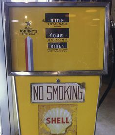 LOVE this repurposed old gas pump. Says it all...