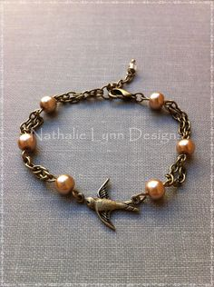 Swallow Bird Glass Pearl Bracelet by nathalielynndesigns on Etsy, $19.99