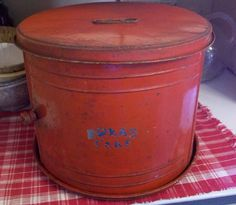 """Use an empty banged up popcorn tin.  Paint it, weather it, use it as """"vintage-looking"""" storage.  Bread - Cakes Safe"""