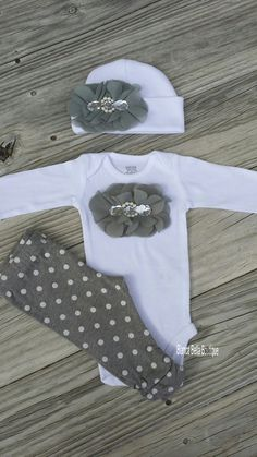 Dress your little princess up in this gorgeous grey and white outfit.This listing is for a bodysuit, pants and hat, all of which are 100%