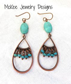 These lightweight beauties are made with blue turquoise howlite stone and copper. The smaller beads in the center are finished with copper ball head pins and the top are faceted teardrop shape. Stones
