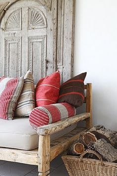 wood. wood. more wood.... GORG handmade sofa w/wood that has been cut down... An old antique door for decor & as a divider... And a basket holding firewood.... Beautiful