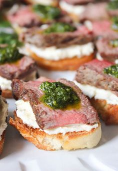 Beef Tenderloin Crostini with Whipped Goat Cheese and Pesto via domesticate-me.com