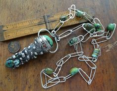 Hollow pendant with Tibetan turquoise by DiPiazzaMetalworks, $245.00
