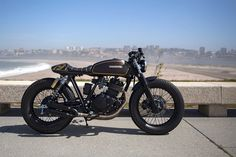 Delivering Smiles: An ex-postal service Suzuki reborn as a funky cafe racer in Portugal.
