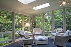 a screen porch that easily transforms into a 3 or 4 season room with the use of PGT Eze-Breeze® Vertical 4-Track windows