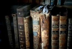 Olde olde books, smelling of must and leather.