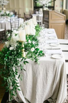 This setting is a bit too dense (too much greenery and candles are too tall) but we like how it drapes down from the top. Head Table Wedding, Wedding Table Settings, Wedding Table Centerpieces, Cherry Blossom Centerpiece, White Centerpiece, White Boutonniere, Boutonnieres, Head Table Decor, Arch Flowers