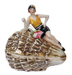 "View Catalog Item - Theriault's Antique Doll Auctions . German Porcelain Powder Box ""Bathing Beauty Posed on Seashell"""