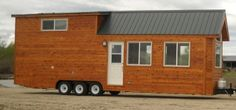 Now here's a tiny house on wheels that more folks might be open to. To me it's like a breed between a Park Model and a Tiny House. Most park models are wider than 8'6″ so yo…
