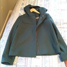 J. Crew coat Beautiful wool fully lined coat. Coat is a dark green and zipper and snaps are rose gold. Two front pockets and one interior pocket. This is NWOT. J. Crew Jackets & Coats