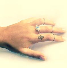 cute small hamsa finger tattoo