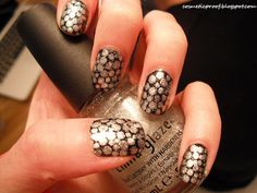 Silver dots on black