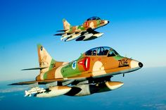 Photo: (c) IAF - Two Skyhawk, armed with air-to-air missiles AIM-9. December 13, 2015, the Israeli Air Force and Space ('H'eil Ha'Avir Ha'Israeli) put an end to the career of its aircraft training and advanced training A-4 Skyhawk during a ceremony at the Hatzerim air base in central Israel. Locally designated 'Ayit (in Hebrew), thirty of the last aircraft still in service until recent weeks ensured the training of young Israeli fighter pilots.