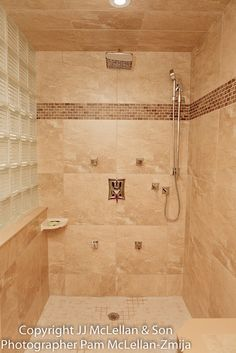 """custom shower """"his"""" side with full body jets, rain shower head and telephone shower head, constant temperature and pressure"""