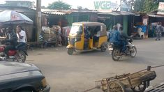 A very busy Wednesday on the street leading to Onike, Iwaya and Makoko from Sabo and Yaba on the mainland of Lagos, Africa's largest megaci. Travel And Tourism, Wednesday, Africa, Street View, Business, Store, Business Illustration