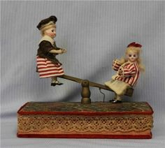 DARLING Antique MUSICAL 2 Closed Mouth Glass eyed Bisque dolls on Seesaw c1890