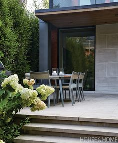 The modern addition was deftly integrated into the terrace by facing the exterior wall in the same Indiana buff limestone. | Photographer:  Virginia Macdonald  Designer:  Sara Bellamy