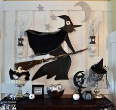 Flying Witch Mantel - 25 Spooky Halloween Mantels   with DIY Tips