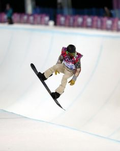 Shaun White of the United States gets air during a snowboard half pipe training session at the Rosa Khutor Extreme Park at the 2014 Winter Olympics, Monday, Feb. 10, 2014, in Krasnaya Polyana, Russia. (AP Photo/Sergei Grits)