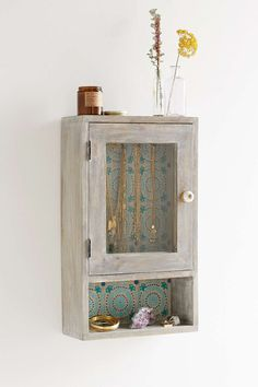 "Plum & Bow Neha Wall Cabinet Product Sku: 35200997; Color Code: 046 Pretty + rustic wall cabinet from UO's own Plum & Bow. Open bottom shelf for extra storage + glass door to keep all your treasures in view. Features hooks inside to hang jewelry. - Mango wood, glass - Length: 11.75"" - Width: 5"" - Height: 20"""
