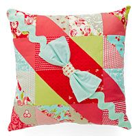 Combine a pack of charm squares and jumbo rickrack to make a stylish pillow.