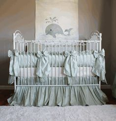 Like the idea of ribbons around the crib, different colors but like the idea