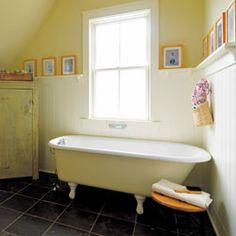 A claw-foot tub, an antique cabinet and a custom-built salvaged wood vanity lend a comforting feeling to this bathroom.