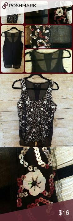 """Top Victoria's Secret beautiful sequined top. Gently worn and in excellent condition. Back is sheer. 26"""" in length and 20"""" across the front. Very pretty!! Victoria's Secret Tops Tank Tops"""