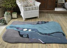 'Diving Down'. A hand tufted rug by Annette Turner by