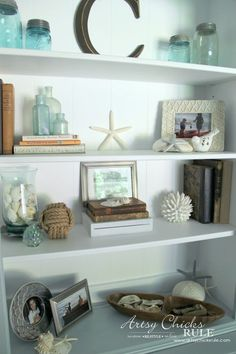 Coastal Styled Bookshelves (how to style shelves) – Bookshelf Decor Coastal Bedrooms, Coastal Living Rooms, Living Room Decor, Coastal Rugs, Coastal Curtains, Coastal Entryway, Beach Themed Living Room, Cottage Bedrooms, Coastal Bedding