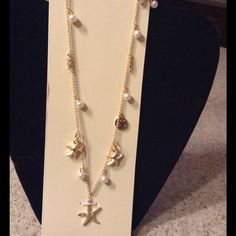 New long gold sea necklace So pretty. Cute charms. Sea horses, pearls, starfish, shells. Great necklace for someone who loves the sea. Long. LC Lauren Conrad Jewelry Necklaces