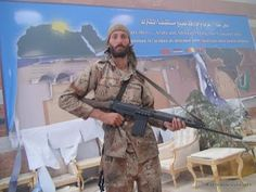 Matthew VanDyke with his FN FAL rifle inside the Ouagadougou conference center in Sirte, Libya War