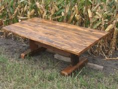 White oak trestle table with mixed patina top. This a natural patina that comes from using sill beams and log cabin timbers.