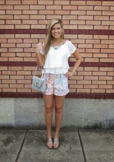 We're kicking off the week with a #Flirty + #Feminine look! These jewel print #HunterBell shorts are complimented with a flouncy #ChelseaFlower top, #KellyWynne handbag & #Nakamol statement necklace. You can't help but have fun in this cute outfit! #fcstyle #frenchcuff