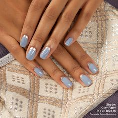 Take mani inspiration from winter's cool hues and paint up this mani for Fashion Week. Brush on Complete Salon Manicure shade, In Full Blue-m, as the base color and use the Gilty Party shade for a reverse French tip near your cuticle.