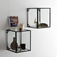 Wall mount glass display boxes for tiny treasures to precious to store away. Westelm.com