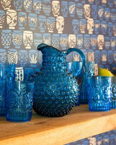 Untitled *wallpaper....floating wood shelf....glassware