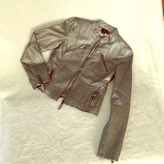 Motorcycle Jacket Silver faux leather jacket. Bronze hardware. In mint condition with lots of life left. Used for a photo shoot and hasn't gotten much use since then. Forever 21 Jackets & Coats