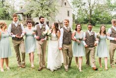 Photo of bride and groom with their bridal party on wedding day by Alysha Christine Photography