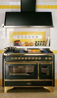 """ILVE 48"""" black w/brass $11,499. ~ swoon worthy...  Would be divine with the creamy white kitchen."""