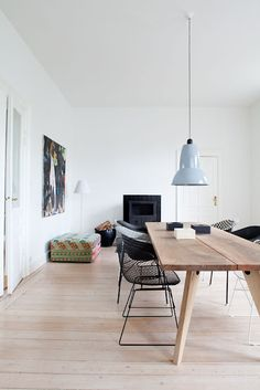 calming, minimal dining space with character and a terrific table