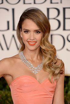 Brides: Best Hairstyles from the 2013 Golden Globes   Wedding Hairstyles   Brides.com  - Jessica Alba's Bouncy Long Waves  Jessica Alba's long side-swept locks are equal parts romantic and glamorous.