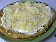 Langos - Hungarian Fried Bread Recipe (If we go a week before trying this recipe, I'll be insanely surprised) Fried Bread Recipe, Bread Recipes, Snack Recipes, Snacks, Hungarian Cuisine, Hungarian Recipes, Hungarian Food, Romanian Recipes, Irish Recipes