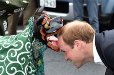 """Prince William: Japan Day 4: Prince William is located in the """"Chime of Hope"""" -Shopping in Onagawa from a traditional lion dancers."""