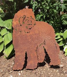 Labradoodle Garden Stake or Wall Hanging. This handcrafted Labradoodle Garden Stake or Wall Hanging will become a decorative favorite. A charming way to add some fun to your home or garden decor. Approximately 21 inches high. Only rustic and black colors are in stock, all other colors are made to order. Custom orders are welcome! The rustic patina also varies on each piece. Looking for different styles? Check out our Labradoodle Plant Stake & Christmas Ornament by following the link...
